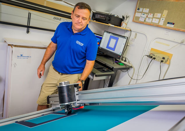 team member with matting machine creating custom mat for framed artwork | Aldecor Custom Framing & Gallery - Naples, Florida